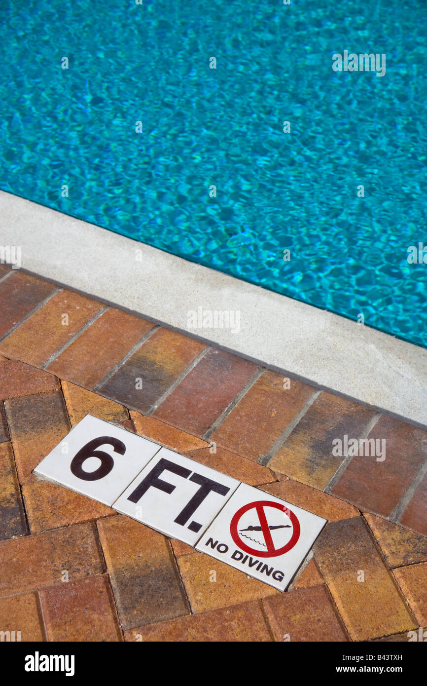 Swimming Pool Depth And No Diving Sign Stock Photo