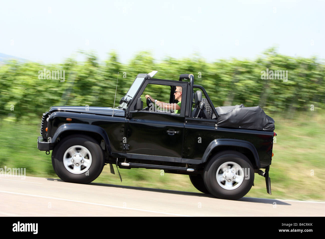 land rover defender convertible two td5 model year 2006 black stock photo royalty free image. Black Bedroom Furniture Sets. Home Design Ideas