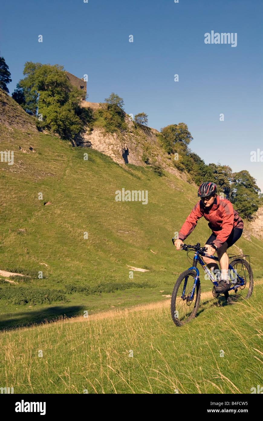 Mountain biking through Cavedale Castleton Peak District National Park Derbyshire England UK GB Stock Photo