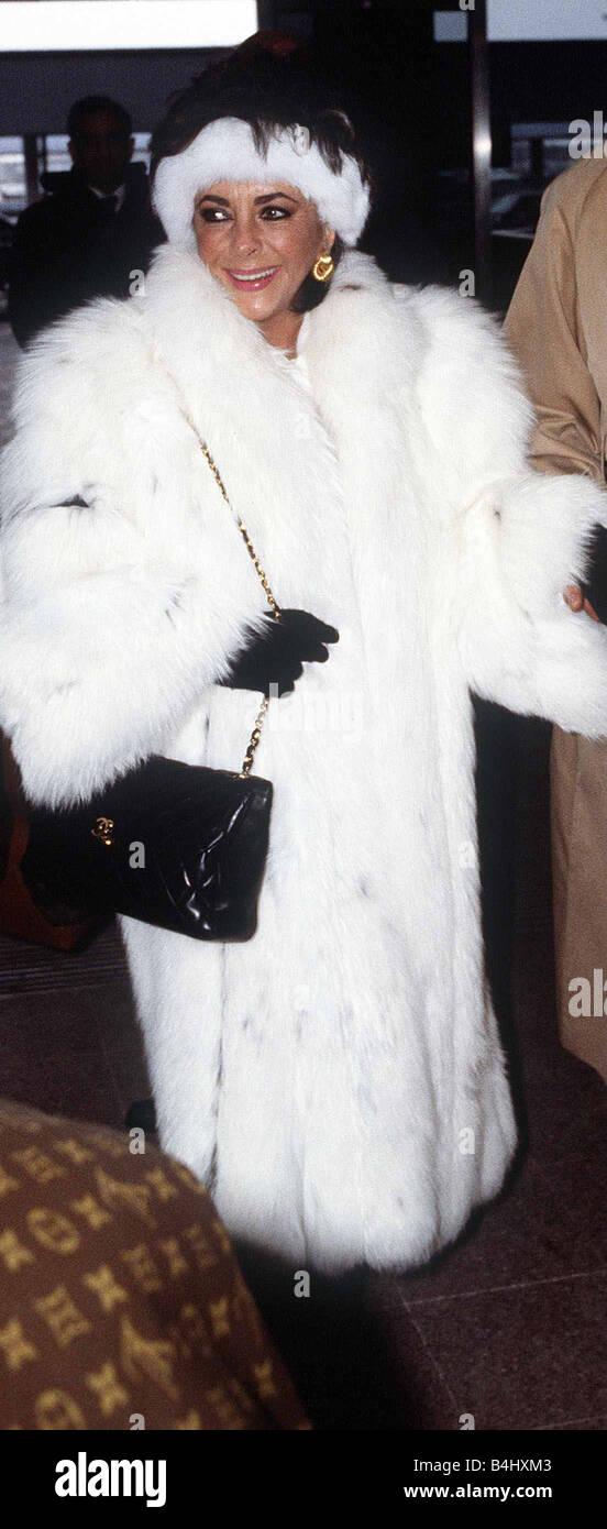 Elizabeth Taylor Jan 1987 Wearing White Fur Coat At