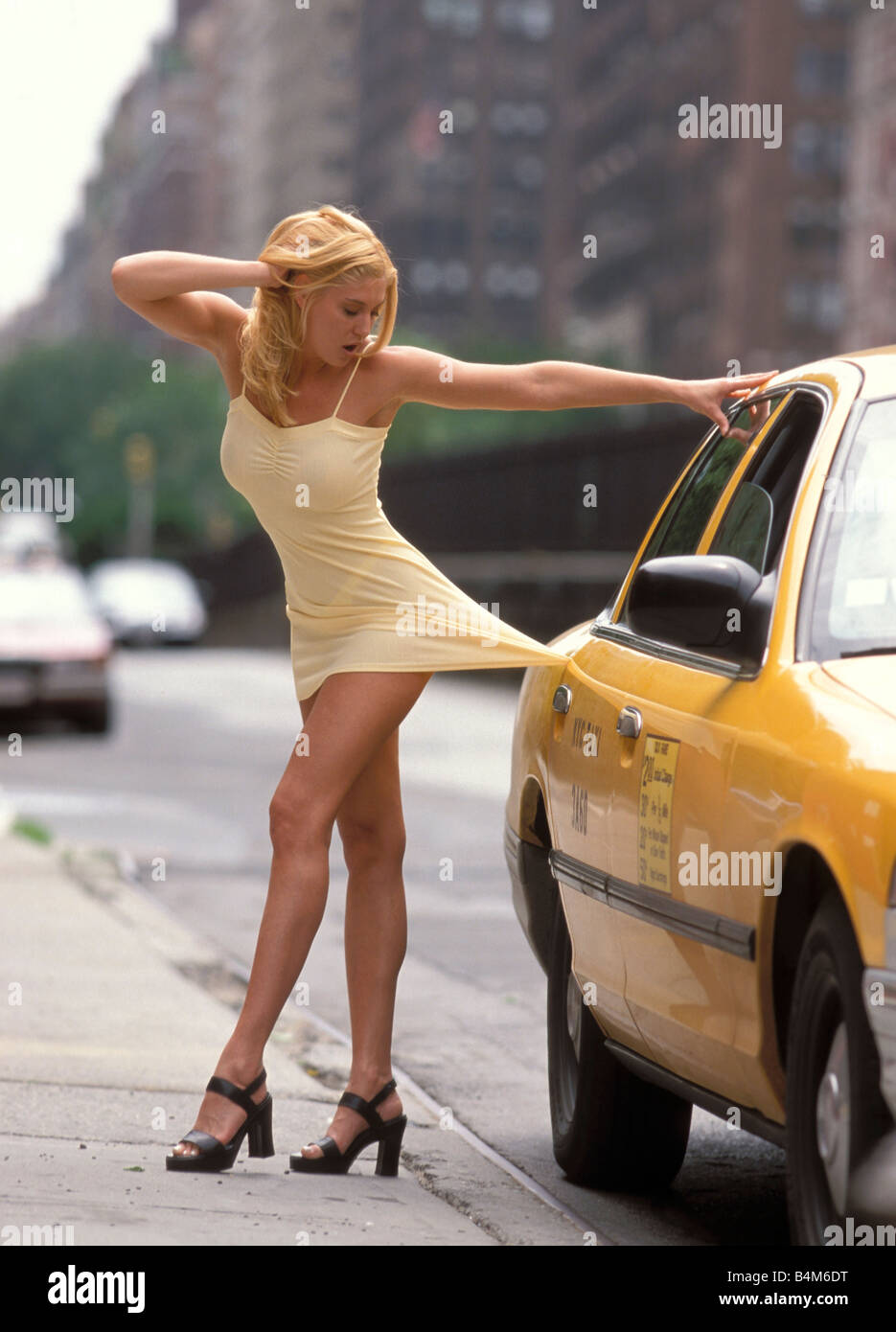 woman-in-yellow-dress-caught-by-a-taxi-s