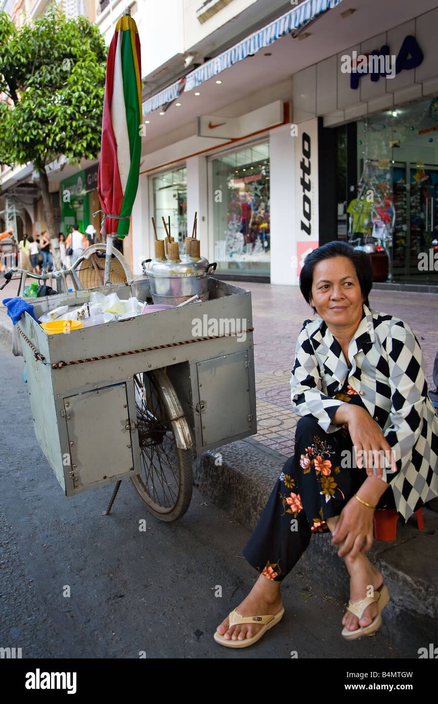 Stock Photo - A street vendor selling traditional Vietnamese pancake on a bicycle