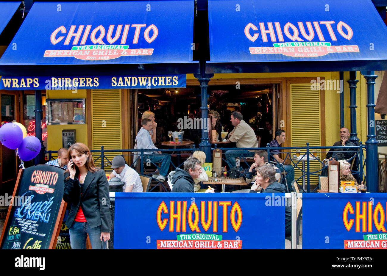 Chiquito terrace pub Soho West End woman with cellphone cell phone mobile telephone London Stock Photo