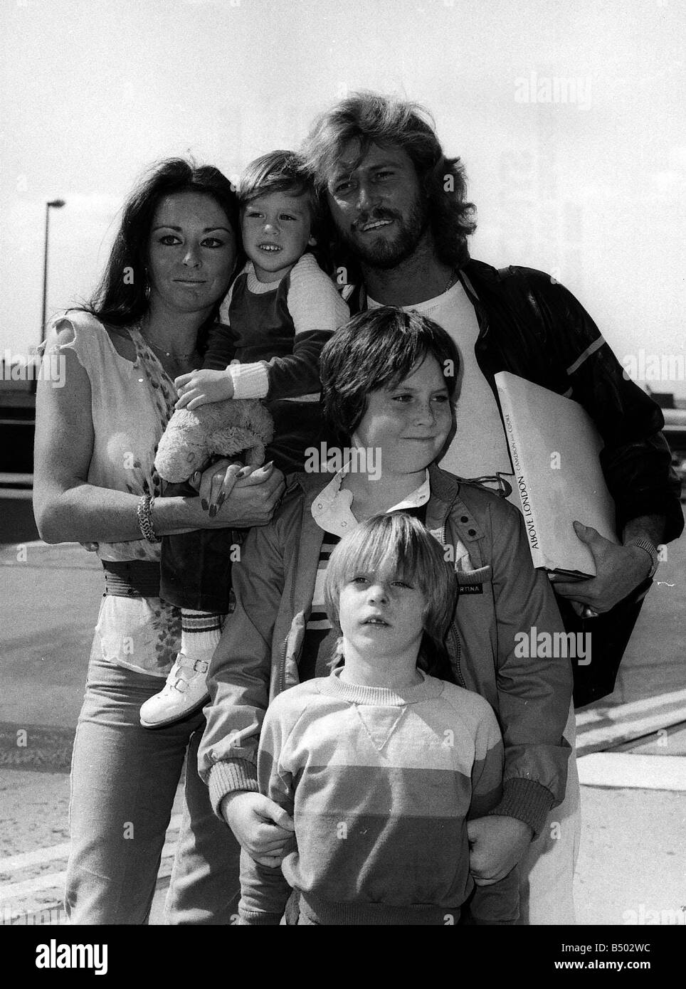 Bee Gees Singer Barry Gibb And Family At Heathrow Airport Stock Photo Royalty Free Image