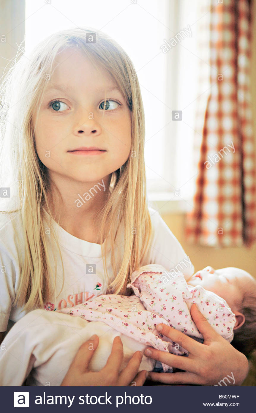 Close up of a girl carrying her sister Stock Foto