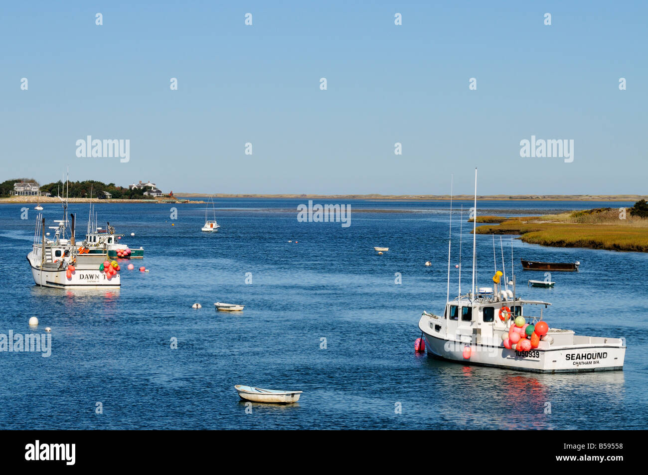 Two 2 Commercial Fishing Boats Moored In Chatham Harbor