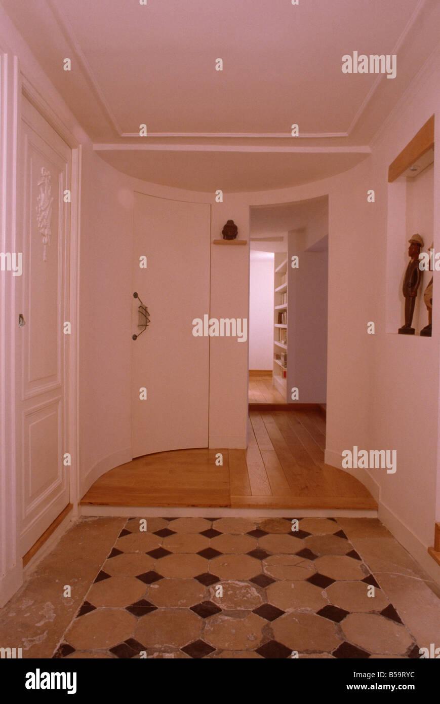 Terracotta floor tiles and wooden flooring in modern white for Modern white floor tile