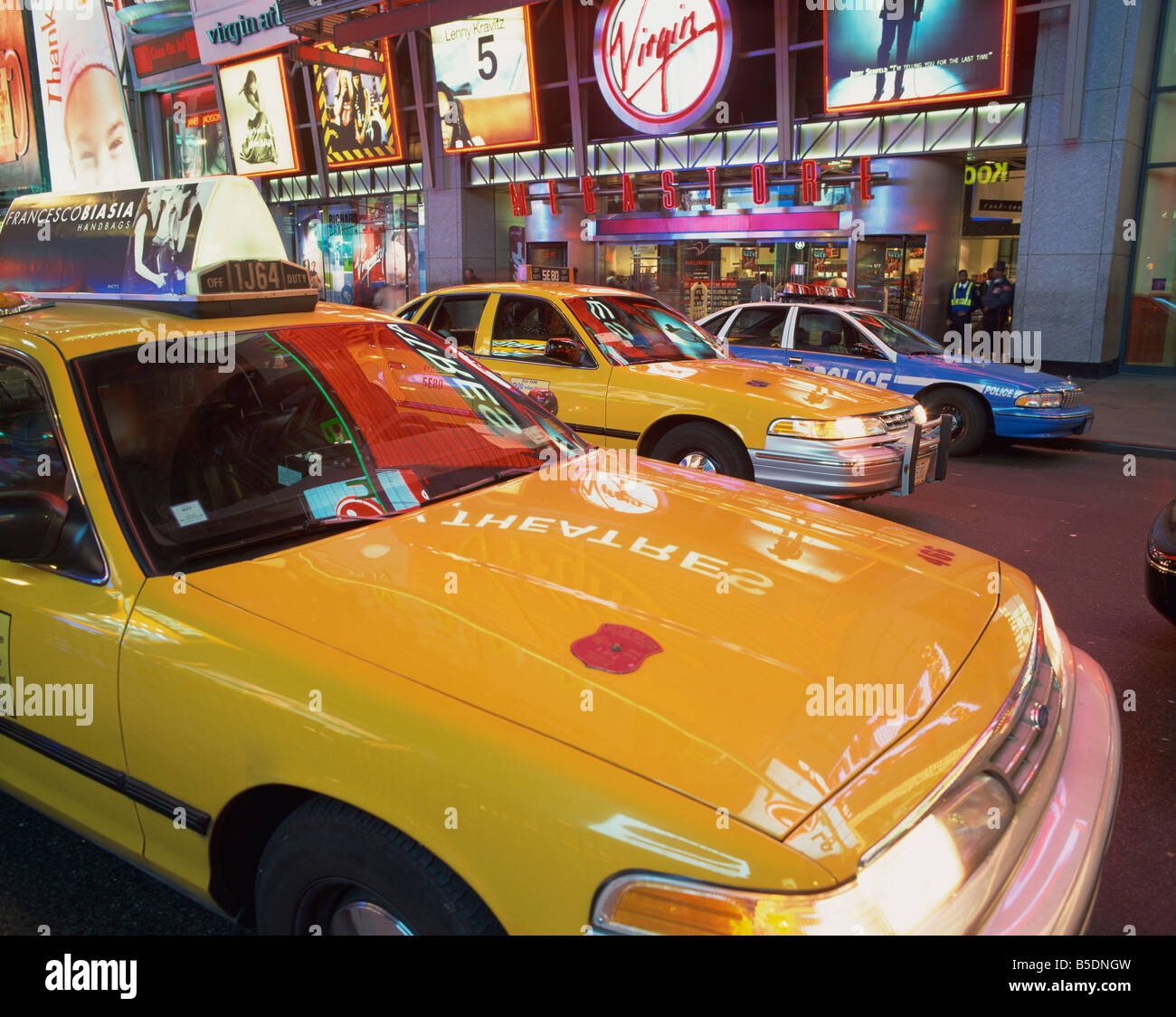 yellow-cabs-on-the-street-at-night-in-ti