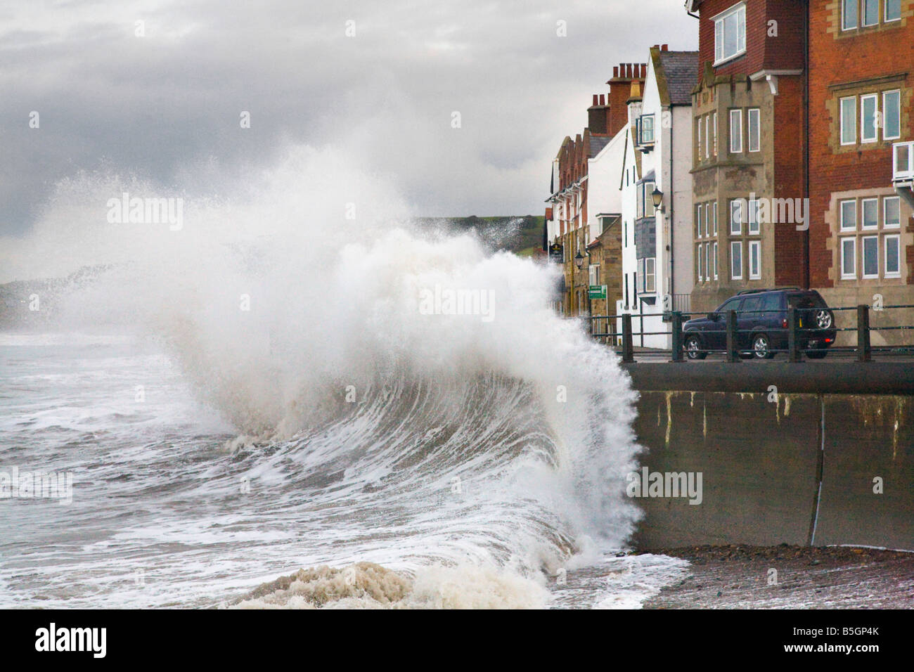 Extreme weather Storm seas surge and wave reflection wall at Sandsend, Whitby, Yorkshire, UK. Seaside properties Stock Photo