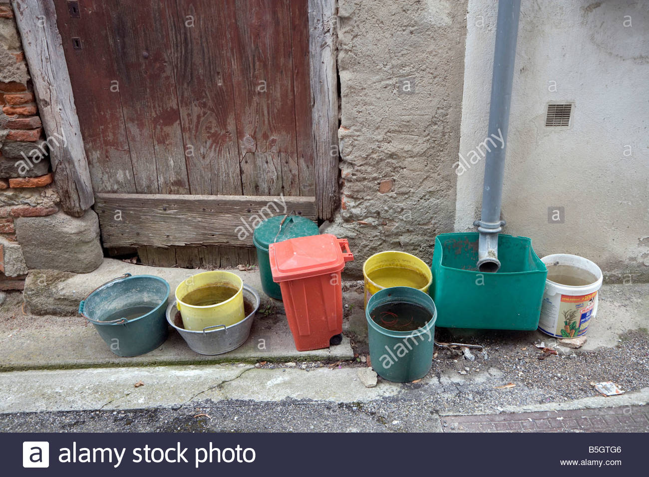 Several buckets at a roof drain pipe to collect the for House roof drain pipes