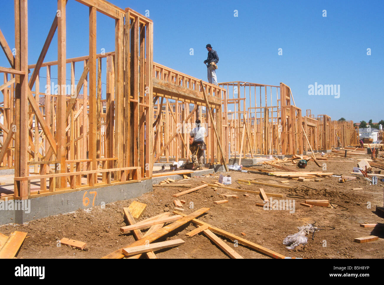 Homes Being Built In Framing Stage Of Construction Stock
