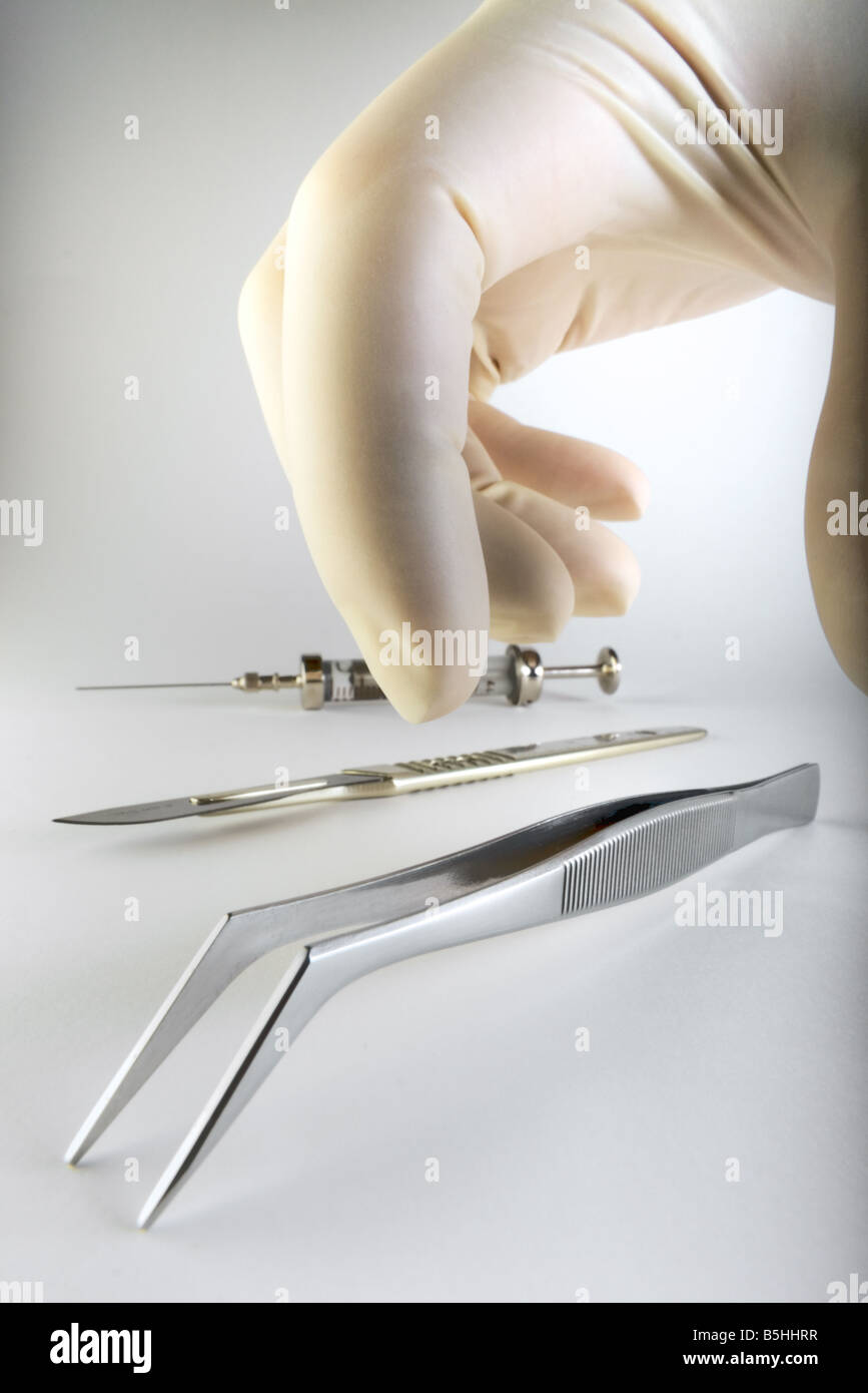 Hand picking up tweezers Stock Photo