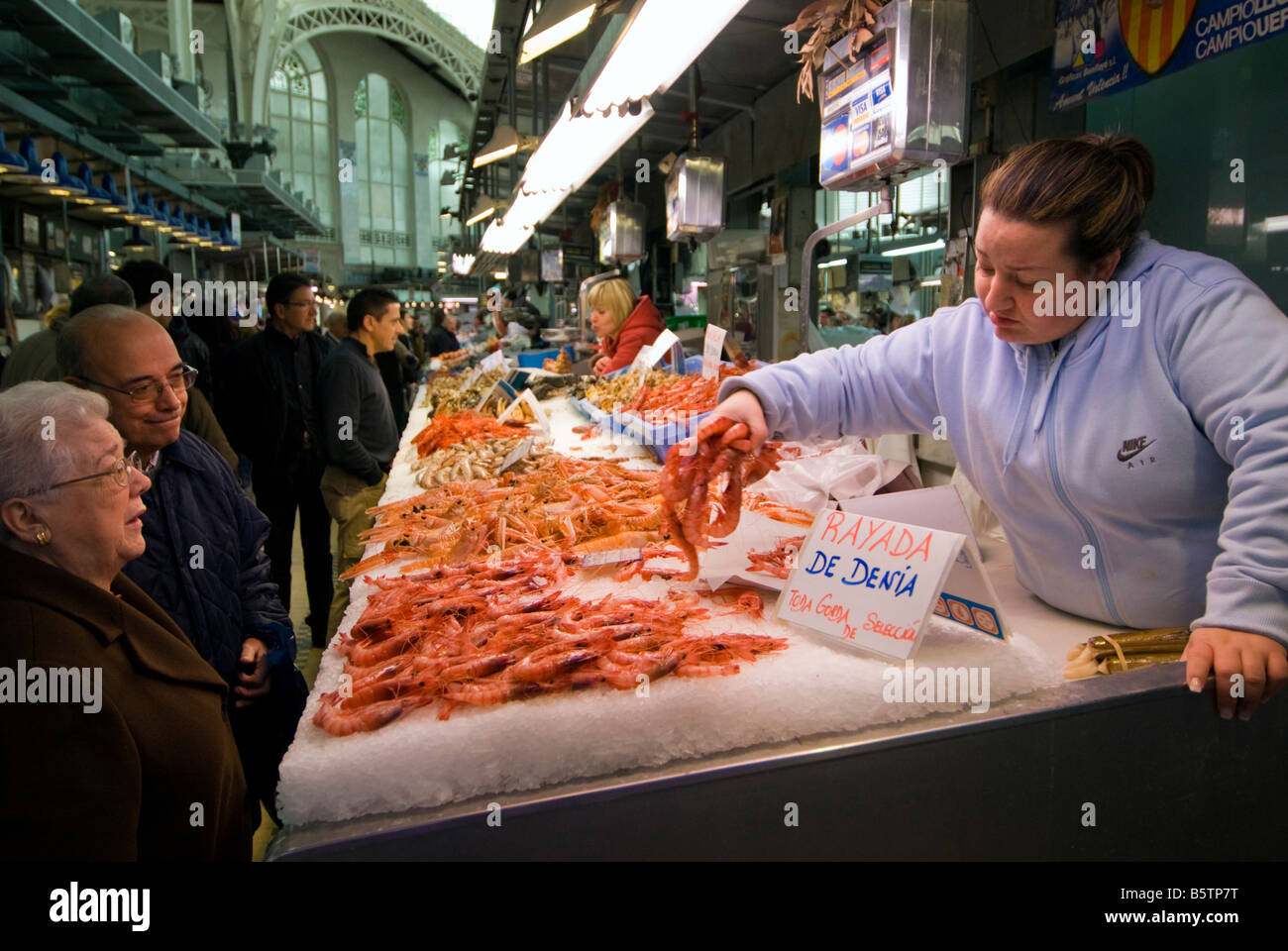 Spanish people buying shrimps in the central fish market for Central fish market