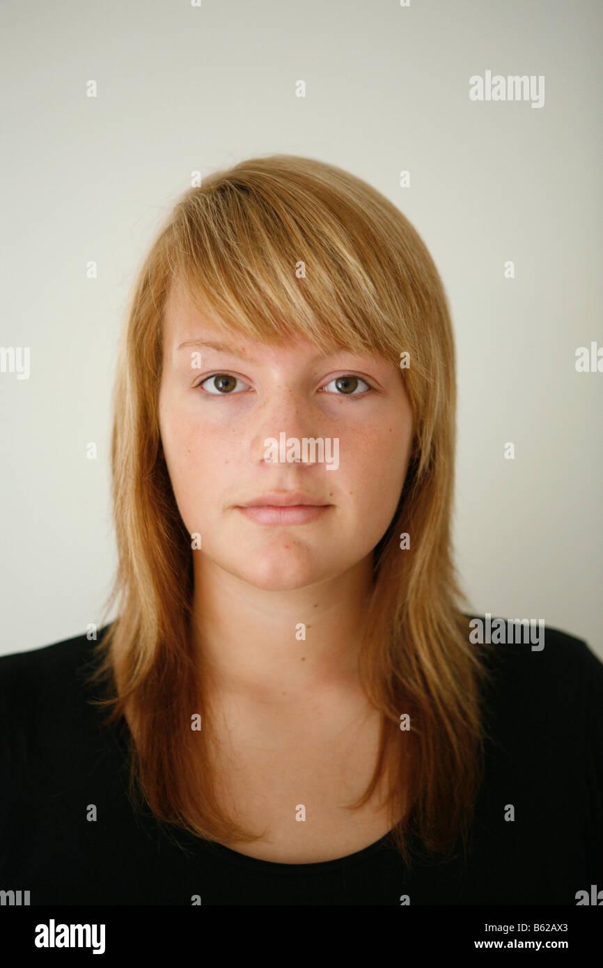 15-year-old girl wearing no makeup - Stock Image