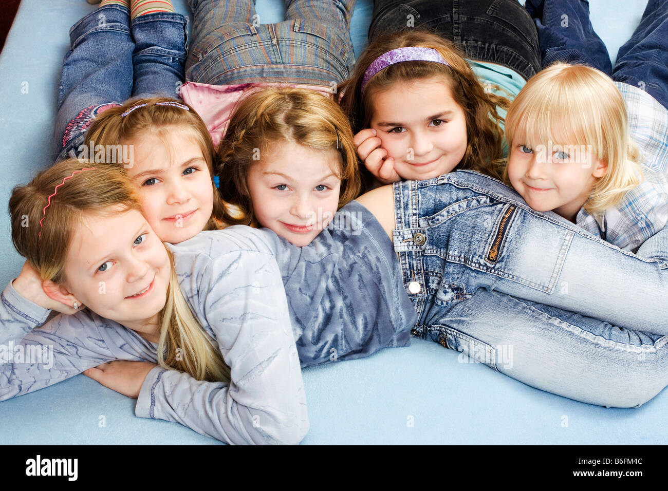 group of children girls from left 11 6 9 and 9 years boy 4 years stock photo royalty free. Black Bedroom Furniture Sets. Home Design Ideas