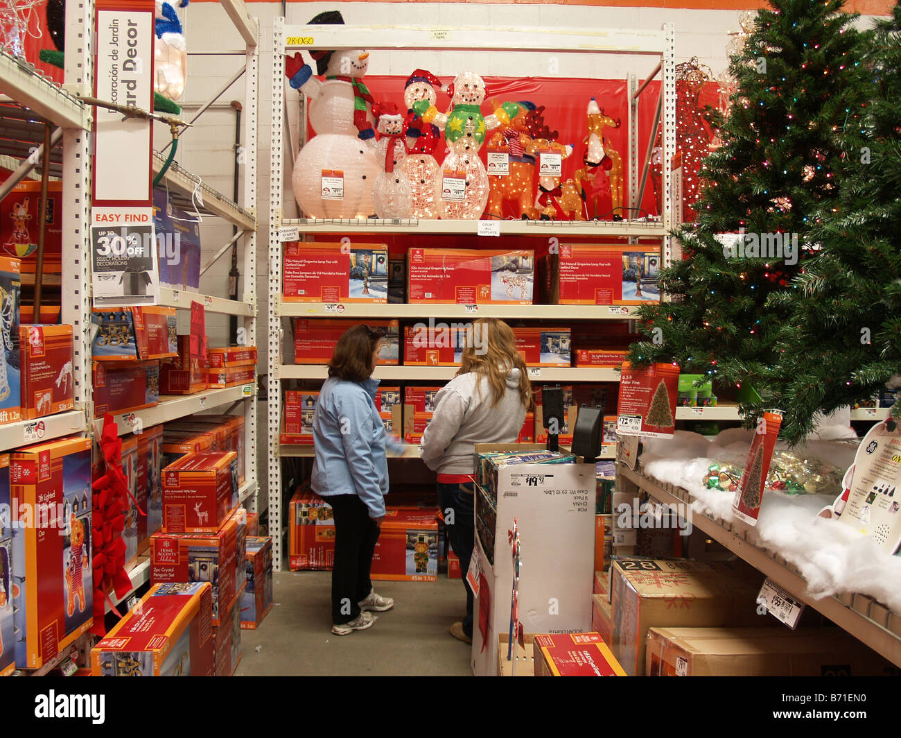 shoppers looking for christmas decorations at a home depot