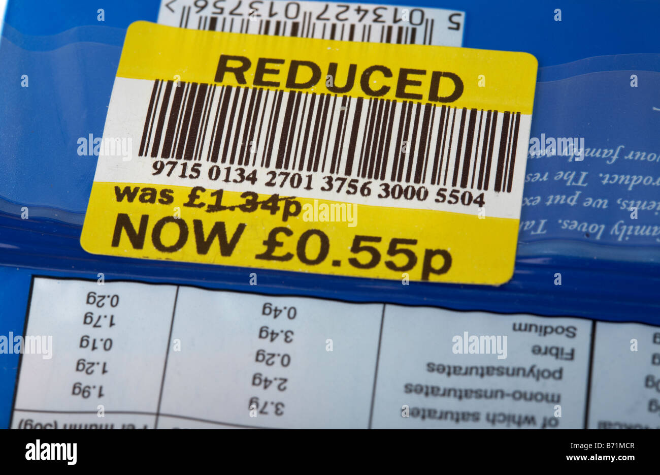 food package with reduced price sticker and bar code on it Stock Photo