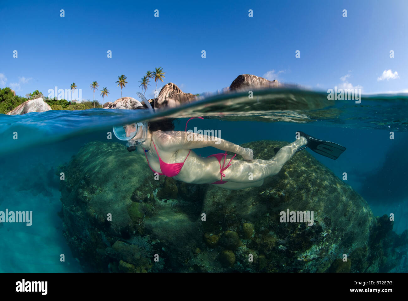 Snorkeling in Baths beach, British Virgin Islands, female diver, oval mask, bikini, blue water, clear water, snorkel, Stock Foto