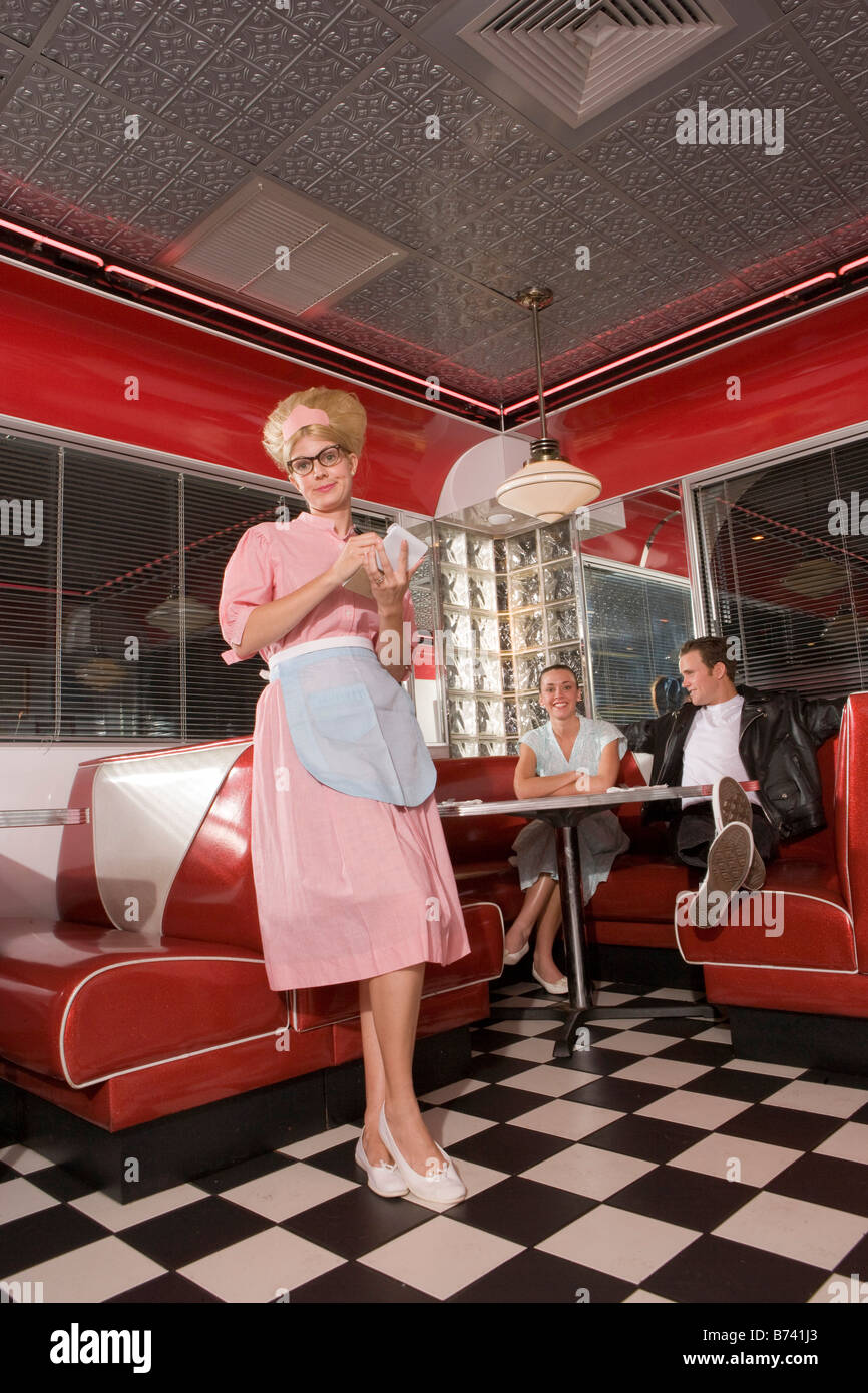 waitress in 1950s style uniform and hairstyle taking order