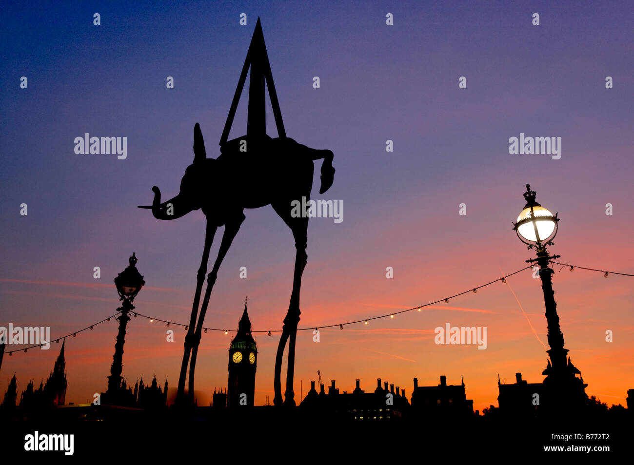 a-statue-of-salvador-dali-space-elephant-and-big-ben-silhouetted-against-B772T2.jpg