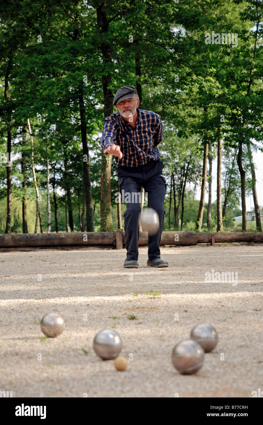 man playing boules petanque provence southern france france stock photo royalty free image. Black Bedroom Furniture Sets. Home Design Ideas