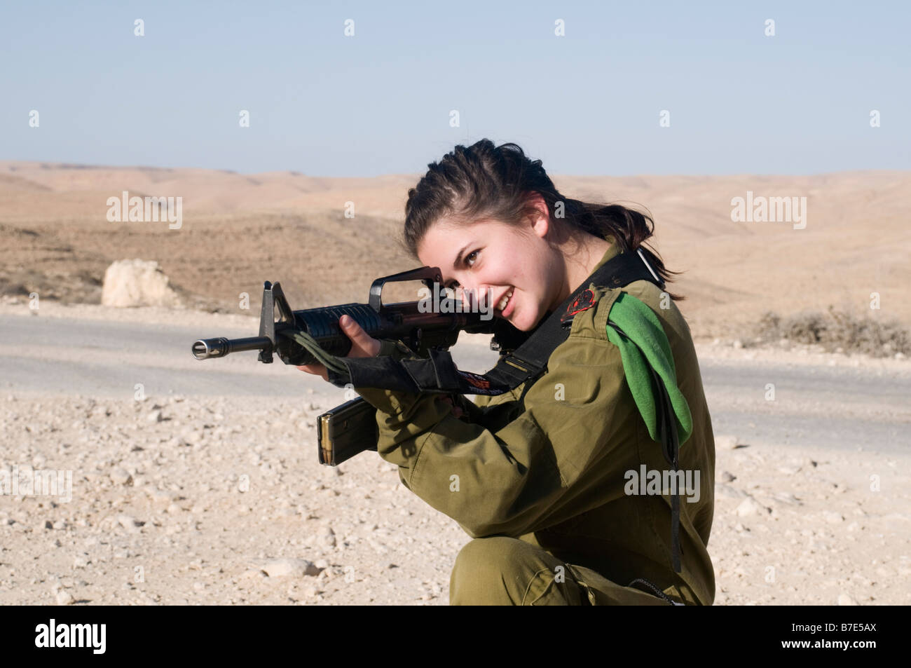 Israeli young female soldier in uniform aiming her M16 ...