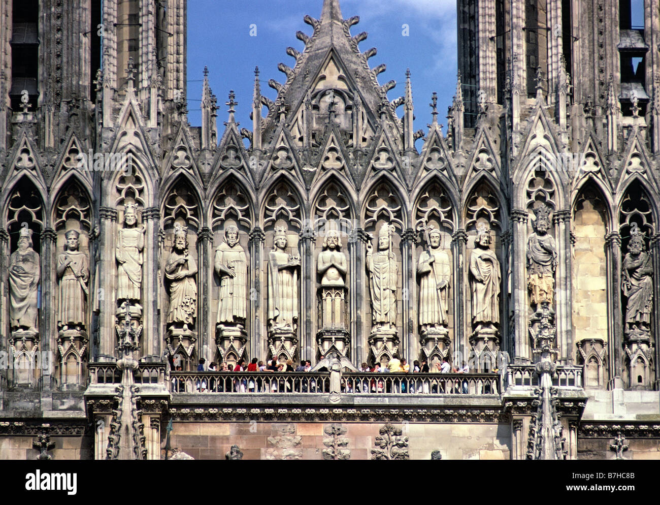 tourists on balcony below the gallery of the kings on west facade of stock photo royalty free. Black Bedroom Furniture Sets. Home Design Ideas