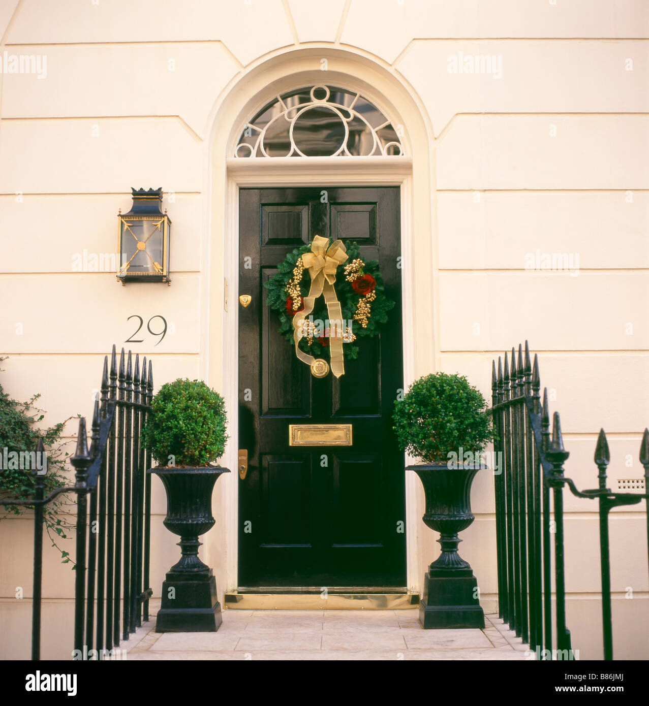 A Christmas Wreath Hanging On The Front Door Of A House In Belgravia Stock Photo Royalty Free