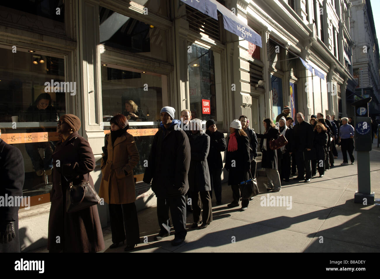 hundreds of people line up in new york for a job fair