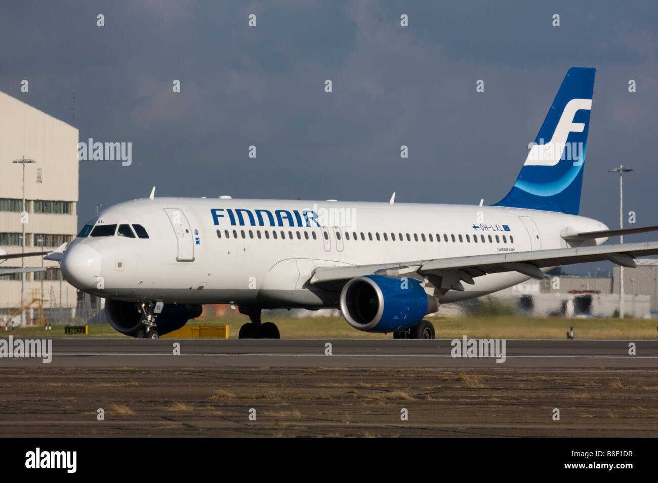 Finnair Airbus A320-214 taxiing for departure at London Heathrow Airport, United Kingdom Stock Photo