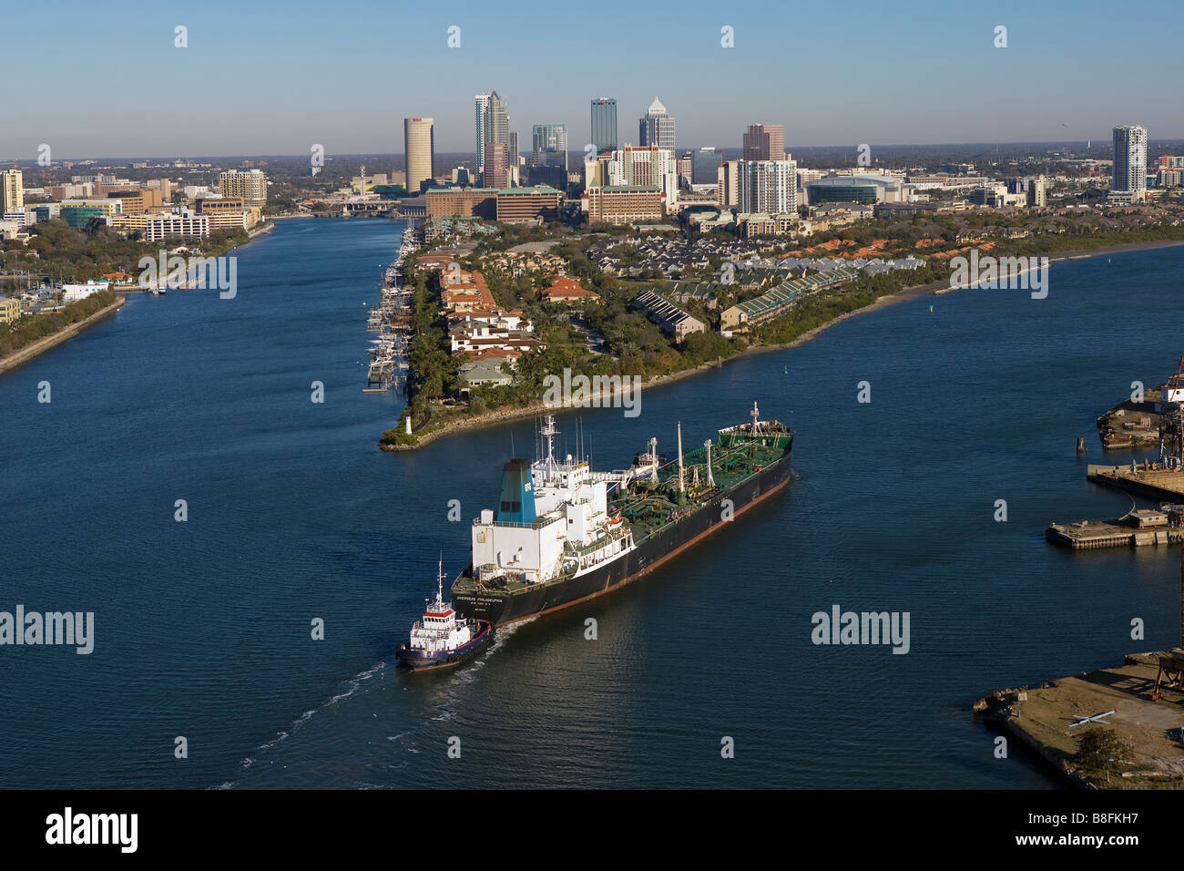 aerial view above tug boat with oil tanker Overseas Philadelphia approaching Port of Tampa Florida Stock Photo