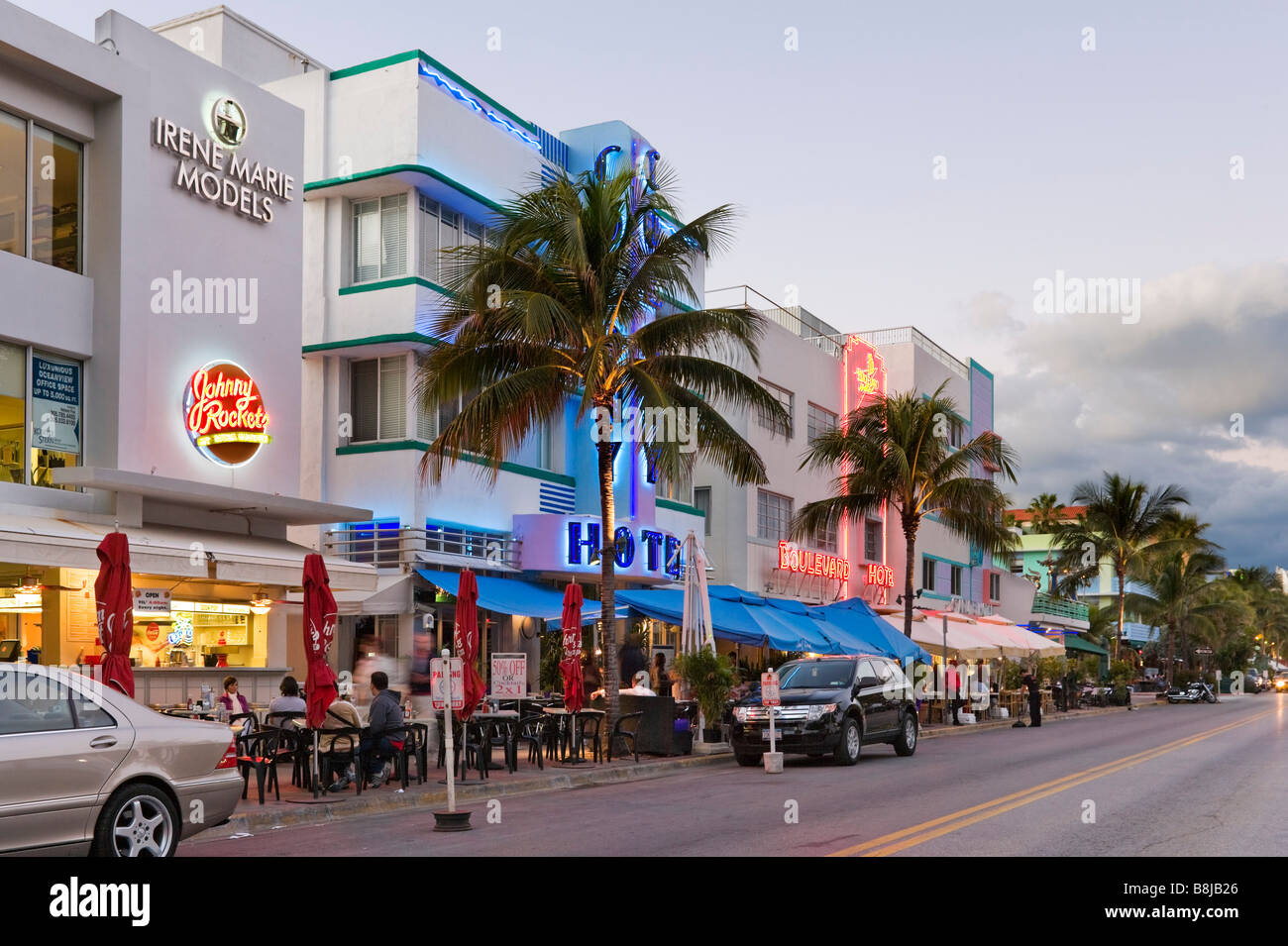 art deco hotels and restaurants on ocean drive at dusk  south beach stock photo  royalty free