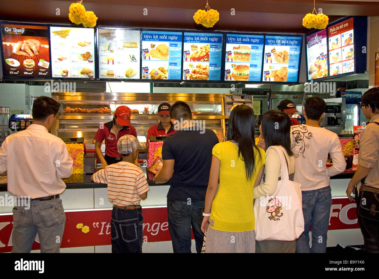 Stock Photo - Vietnamese people eat at a KFC restaurant inside the Diamond Plaza shopping center in downtown Ho Chi Minh City Vietnam