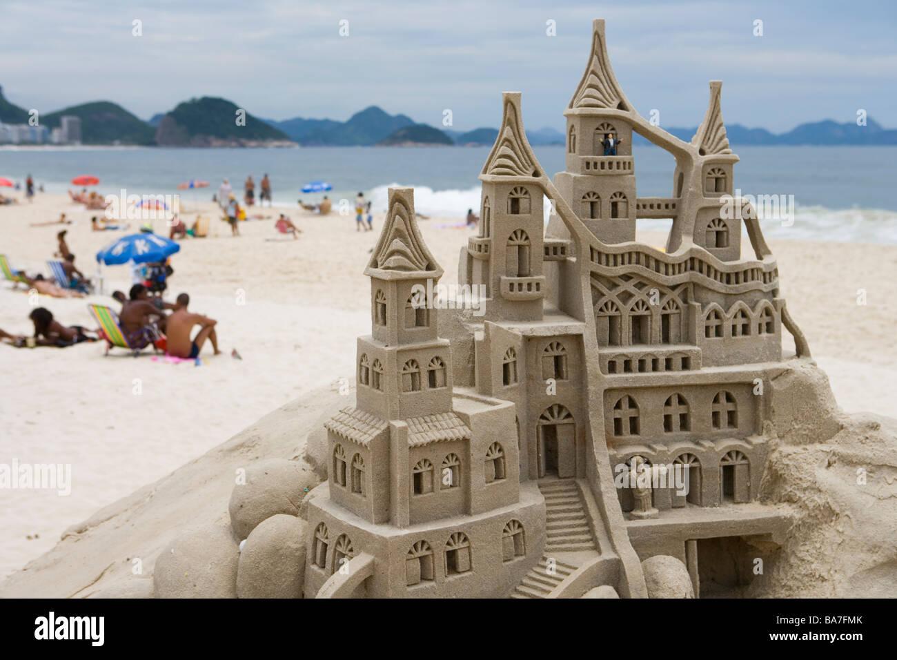 Building Sand Castles : Building sand castles with nativity scene on copacabana