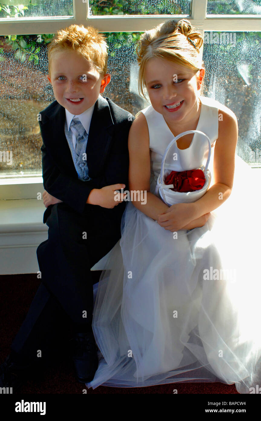 Adorable Boy And Girl In Their Ring Bearer Tuxedo And