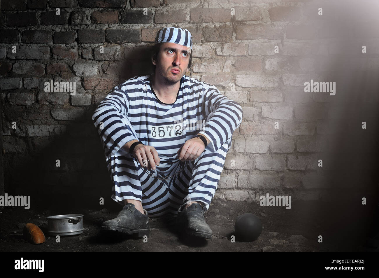 Prisoner in chains sitting on the floor of a prison cell ... Pictures Of Prisoners In Chains