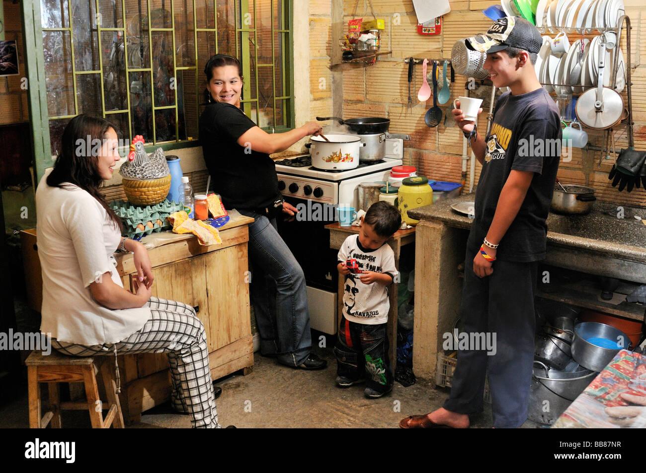 Family In A Modest Kitchen, Slums Of Uzme, Soacha, Bogotá ...