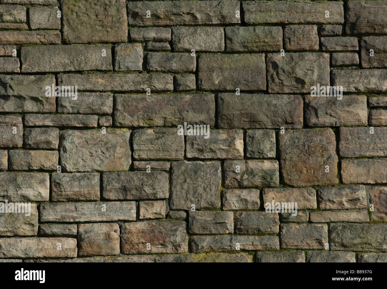 a stone wall made of natural stone bricks stock photo royalty free image 24171716 alamy. Black Bedroom Furniture Sets. Home Design Ideas