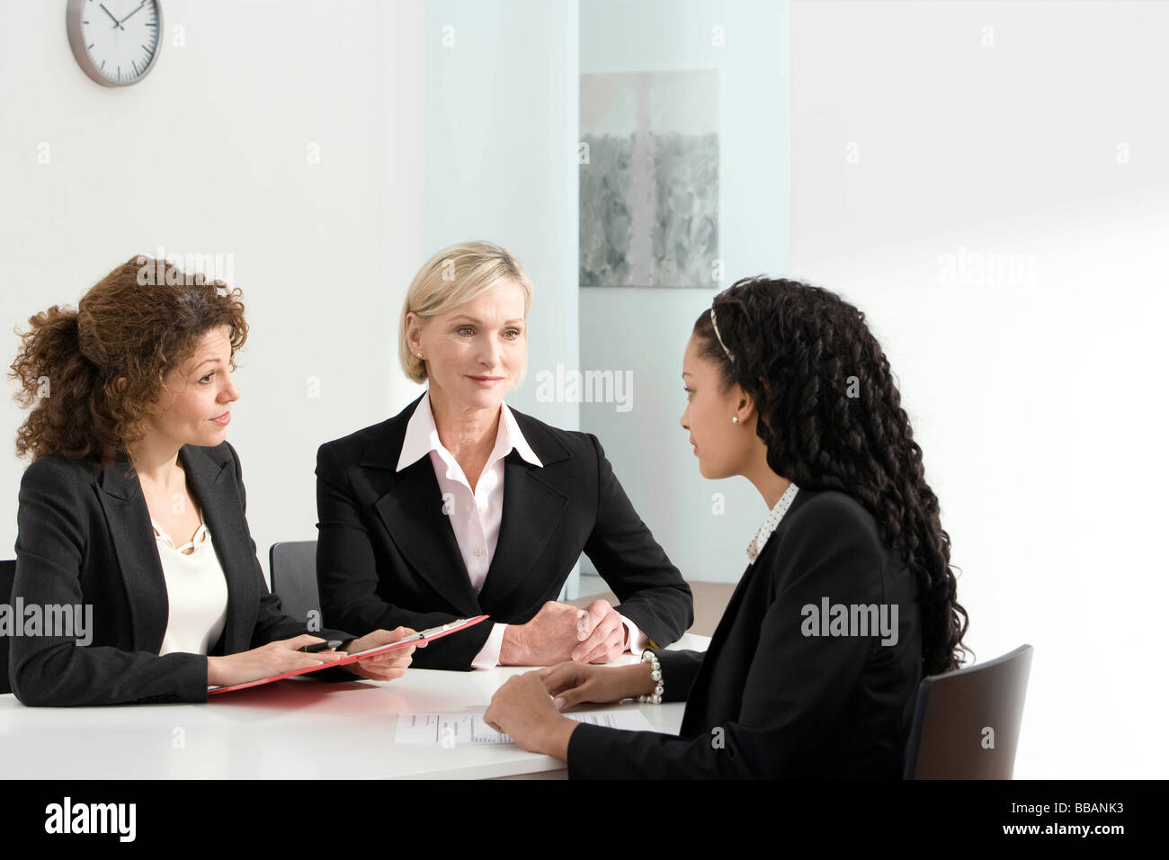 two-business-women-conduct-an-interview-