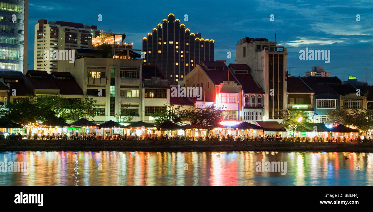 Skyline of Singapur Boat Quay Restaurant bars at night South East Asia twilight Stock Photo