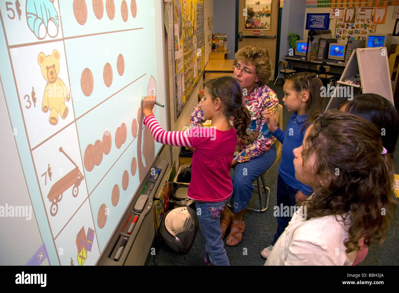 Kindergarten Calendar Interactive Whiteboard : Kindergarten students use an interactive whiteboard in the