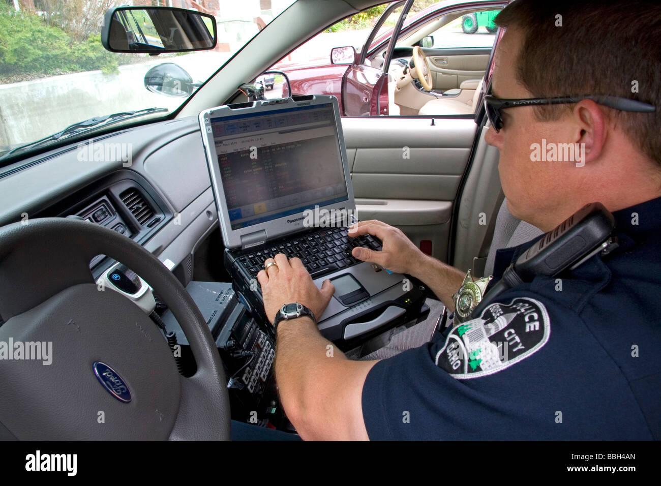 police officer using a mobile data terminal computer inside a police stock photo royalty free. Black Bedroom Furniture Sets. Home Design Ideas