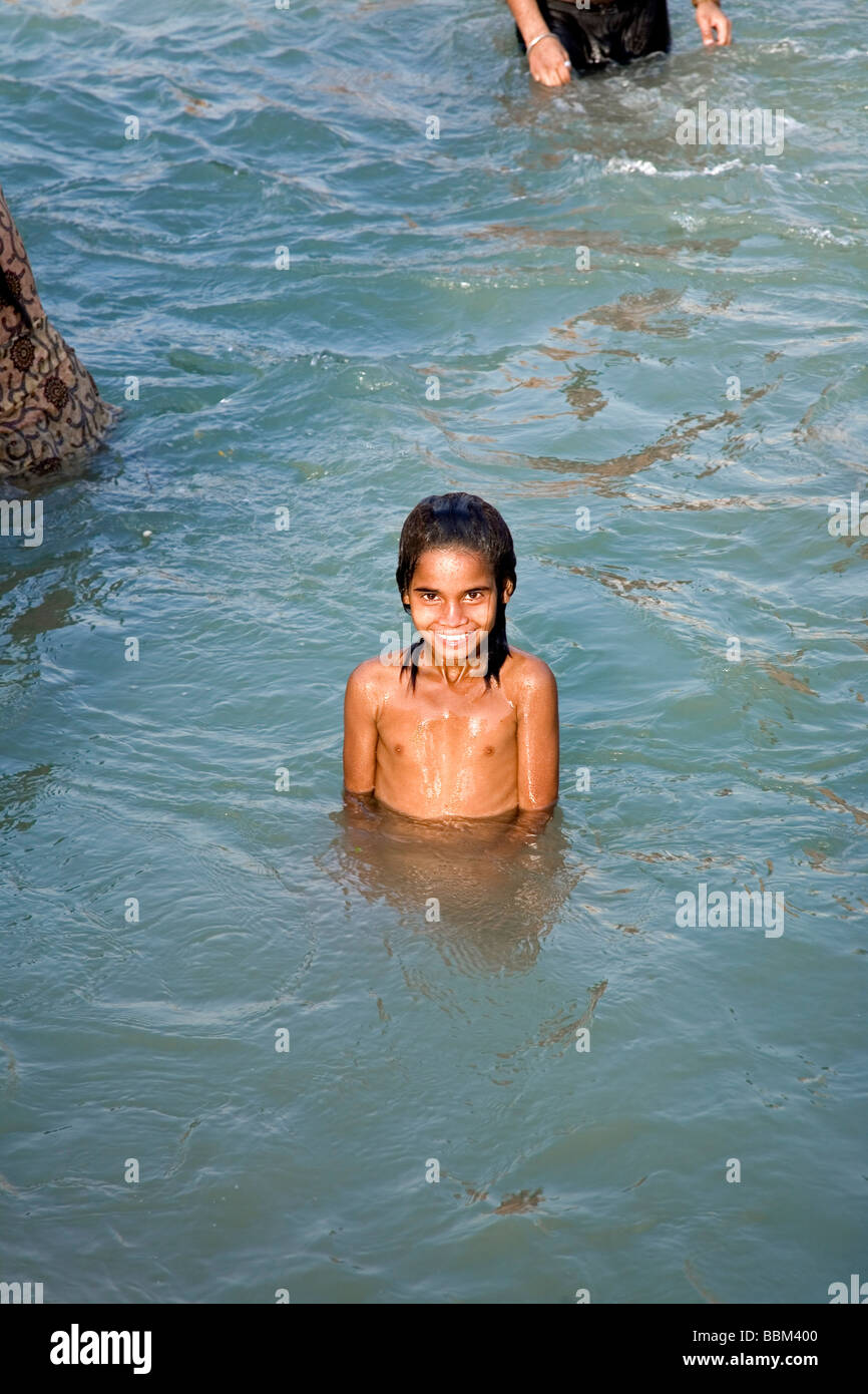 Indian girl bathing in the Ganges river. Haridwar ...