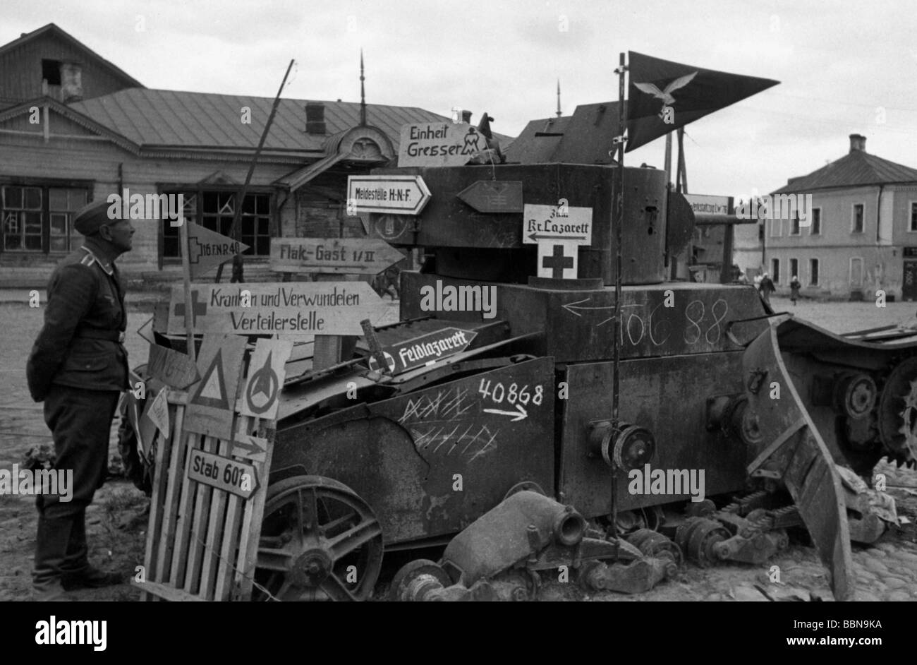 events, Second World War / WWII, Russia 1941, Wehrmacht direction signs on a destroyed Soviet tank T-26, Smolensk, Stock Photo
