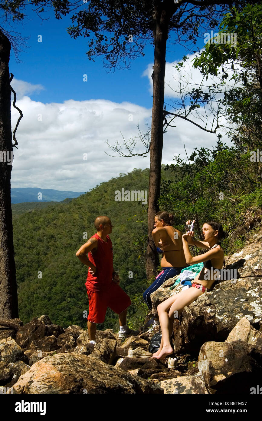 Trekkers resting on the way to Agua Fria Waterfall Chapada dos Veadeiros Veadeiros Tableland Goias Brazil Stock Photo