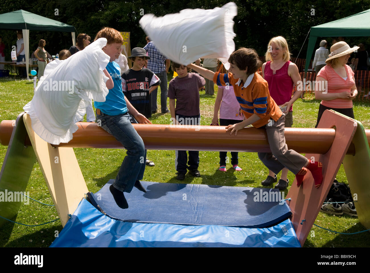 Kids Having A Pillow Fight On The Slippery Pole At A