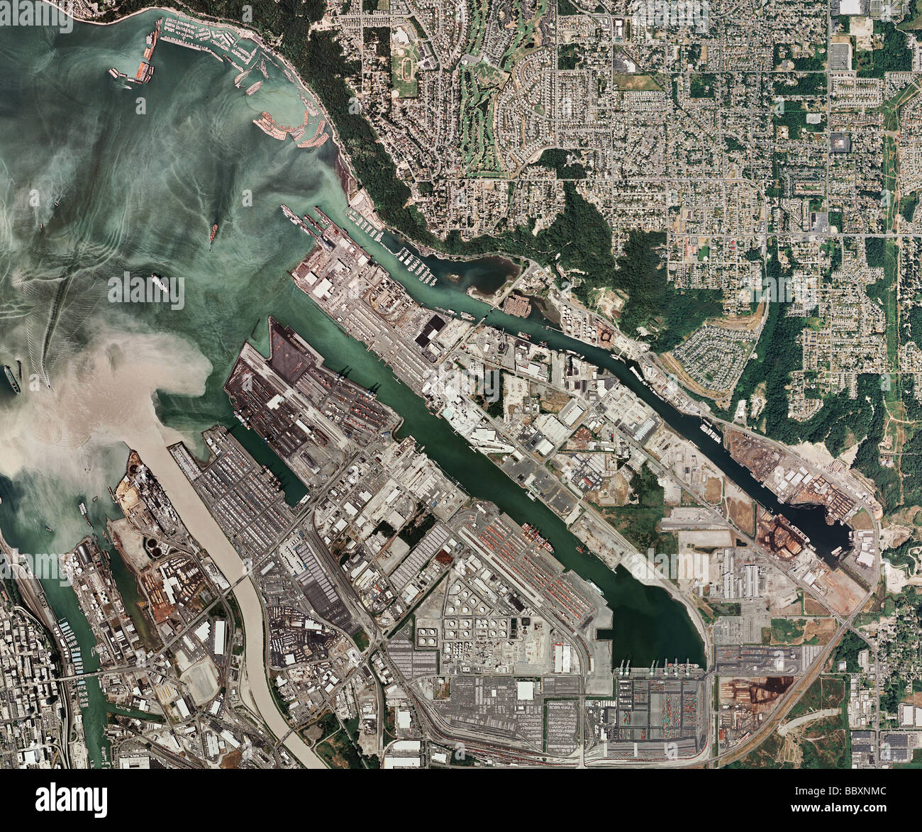 aerial map view above Port of Tacoma Washington; sediment carried by Puyallup River flows into Commencement Bay Stock Photo