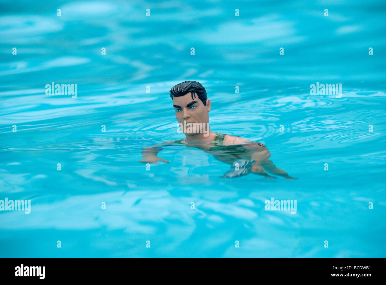 Swimming Pool Action : Action man in swimming pool stock photo royalty free