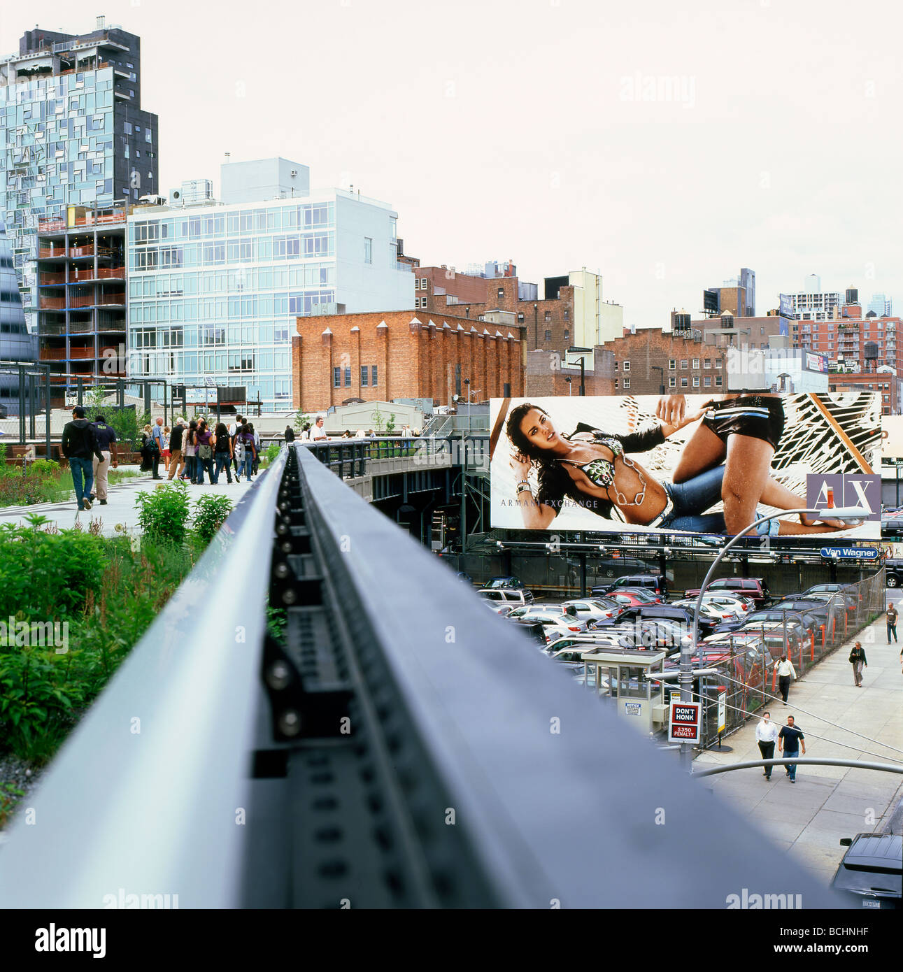 the new high line park rising above streets and billboards in the stock photo royalty free. Black Bedroom Furniture Sets. Home Design Ideas