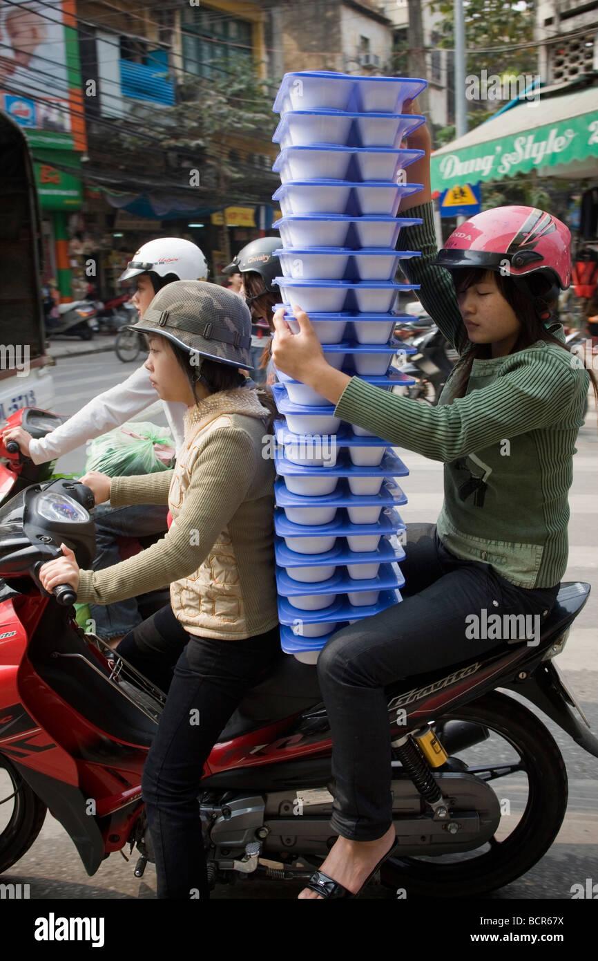 Stock Photo - Food Delivery on Motorbike Hanoi Vietnam